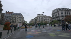 People walking over the colorful spots drawn on Boulevard Anspachlaan, Brussels Stock Footage