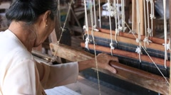 Burmese textile manufacturer in craft village where women work. Myanmar Stock Footage