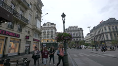 Young people walking on Rue Henri Maus in Brussels Stock Footage