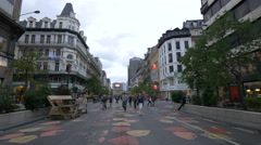 Men and women walking on Boulevard Anspachlaan in Brussels Stock Footage