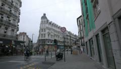 Riding bikes on Rue Auguste Orts in Brussels Stock Footage