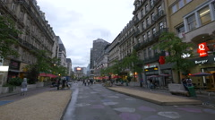 Tourists walking on Boulevard Anspachlaan in Brussels Stock Footage
