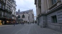 Man and women walking on Rue de la Bourse in Brussels Stock Footage