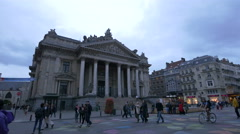 People walking by the Brussels Stock Exchange building Stock Footage
