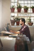 Entrepreneur working in an office space Stock Photos