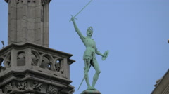 Statue with sword and shield at City Museum in Grand Place in Brussels Stock Footage