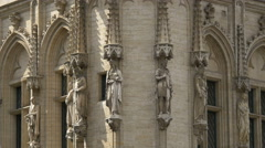 Statues decorating the facade of the Town Hall, in Grand Place in Brussels Stock Footage
