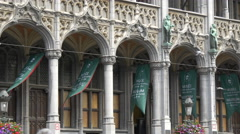 Green flags waving in the corridor of the City Museum in Grand Place in Brussels Stock Footage
