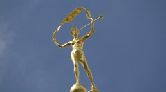 Golden statue on top of the Maison du Roi d'Espagne in Grand Place in Brussels Stock Footage