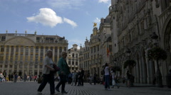 Pan left view of tourists and locals walking in Grand Place in Brussels Stock Footage