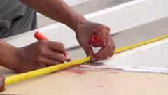 Hands make measurement and mark on metal work. Industrial handicraft manual work - stock footage