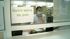 A young nurse takes a call in the clinic. Stock Footage