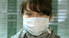 A young woman with anti-viral mask on her face. Stock Footage