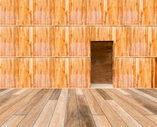 Stock Photo of wooden wall with door and wood floor in front off