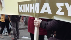 Hand of old woman holding sign in political protest Stock Footage