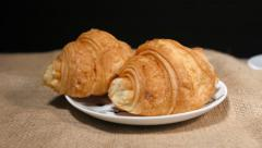 Coffee Beans, Cup, Cinnamon and Croissant on Bagging - stock footage