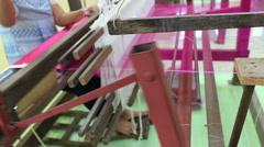 Weaving brocade using a traditional loom machine with yarn Stock Footage