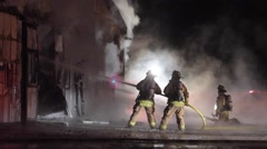 Firefighters Spray Water at Barn Fire Stock Footage