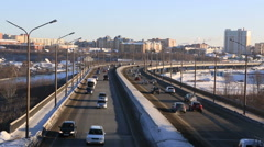 Car traffic on bridge. Winter city Omsk. Timelapse Stock Footage