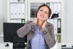 Businesswoman Suffering From Neck Pain Kuvituskuvat