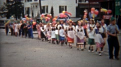 1945: Kids balloon parade walking thru downtown main street. Stock Footage