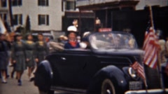 1945: Girl and boy scouts parading thru downtown mainstreet. - stock footage