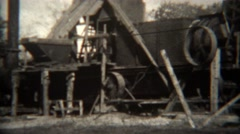 1939: Spinning pulley powered lumber mill factory running full speed. Stock Footage