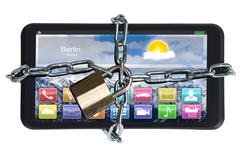 Closeup of digital tablet trapped with padlock and chain against white backgr - stock photo