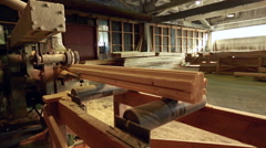 Sawmill. View of pulling profiled timber Stock Footage