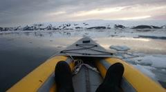 Kayaking Deception Bay, Antarctica at sunset Stock Footage