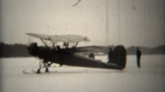 1939: Propeller snowski biplanes taxi on frozen lake. Stock Footage