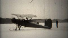 1939: Propeller snowski biplanes taxi on frozen lake. Stock Footage