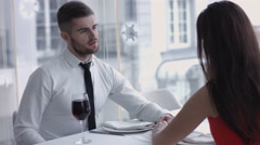 Young man giving a toast and drinking wine together with his adorable lady Stock Footage