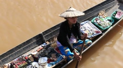 Burmese woman on small long wooden boat selling souvenirs. Inle lake, Myanmar Stock Footage