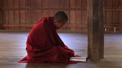 Burmese young monks read mantras in a convent school . Inle lake, Myanmar, Burma Stock Footage