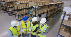 4K Portrait of smiling mixed ethnicity management team in industrial warehouse.  - stock footage