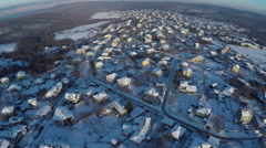 Aerial view, flight over houses in the winter countryside Arkistovideo