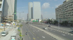 TEL-AVIV, ISRAEL  Light traffic on Menachem Begin street Stock Footage
