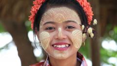 Portrait young girl with thanaka on her smile face. Mandalay, Myanmar Stock Footage