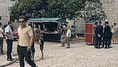 Porec 1967: people walking downtown Stock Footage