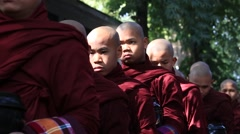 Buddhist monks procession for getting the daily lunch .Mandalay, Myanmar, Burma Stock Footage