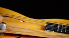 Electric Guitar Rotating, detail of pickup, strings and efes Stock Footage