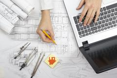 Architect working on blueprint. Architects workplace - architectural project Stock Photos