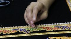 Burmese tapestry masters women work with kalaga. Mandalay, Myanmar, Burma Stock Footage