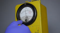 Hand holding geiger counter radioactivity monitor Stock Footage