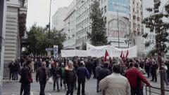 People protest on the streets during the general strike in Greece Feb 2016 Stock Footage