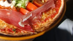 Montagnard pizza with prosciutto Stock Footage