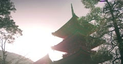 Bright, warm morning light over orange temple - stock footage