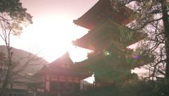 warm light on orange temple tilt shot - stock footage