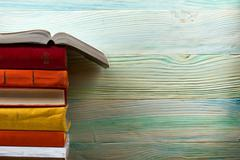 Open book, hardback books on wooden table. Back to school. Copy space Stock Photos